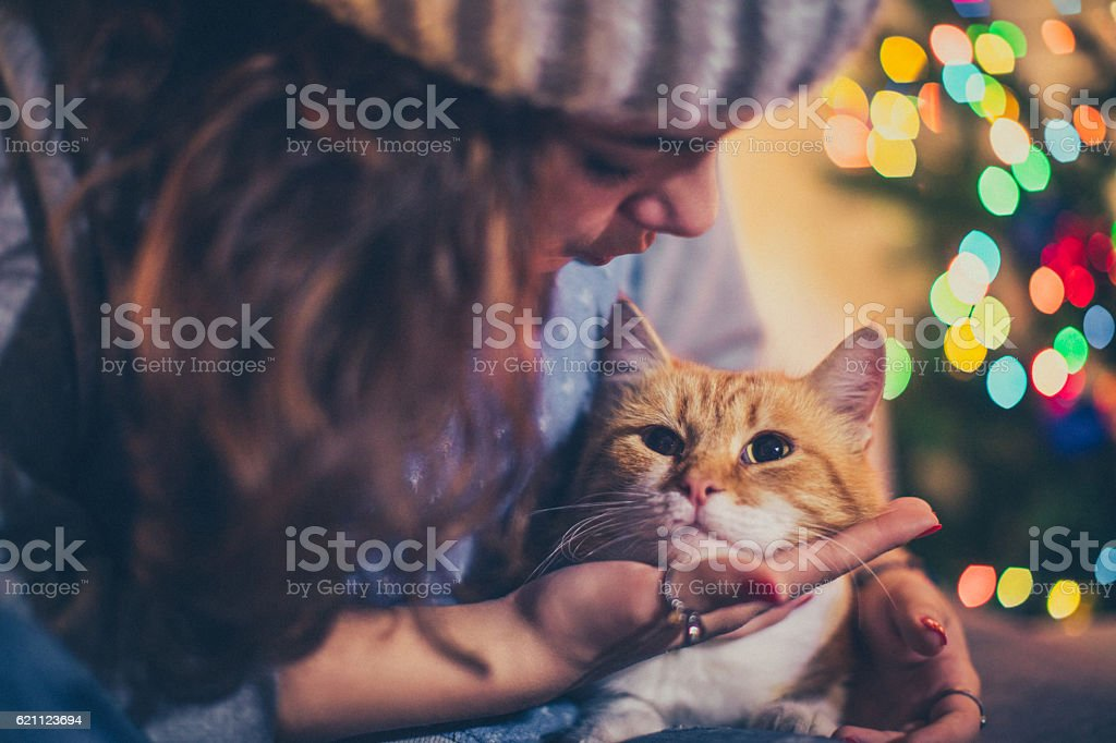 Cuddling with her cat stock photo