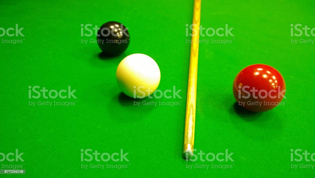 Cue, black, red and white ball to play snooker on the table . The view from the top stock photo