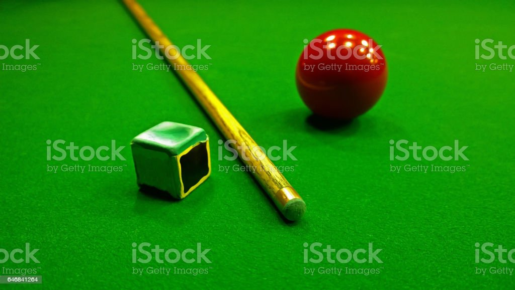 Cue, chalk and snooker ball are on the table stock photo