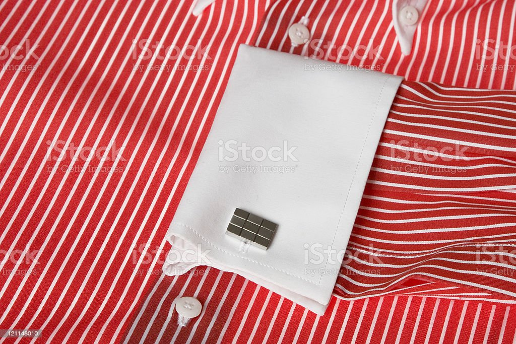 cuff link on men's red shirt royalty-free stock photo