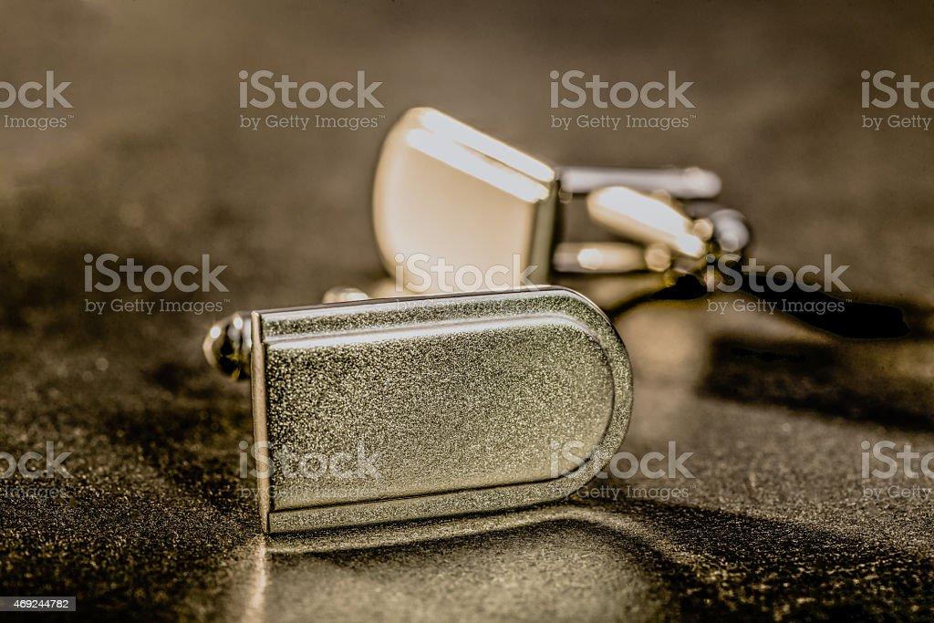 Cuff Links on Dark Surface stock photo
