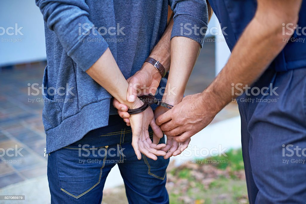 Cuffing a criminal stock photo