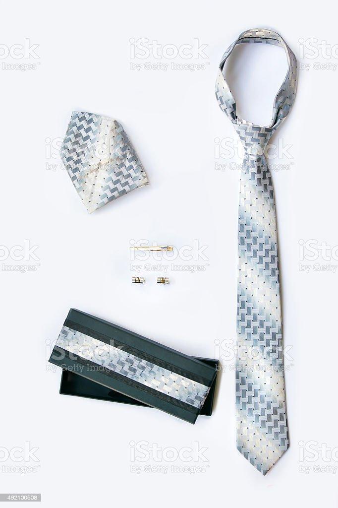 Cufflinks, tie and tie clip, handkerchief and gift box. stock photo