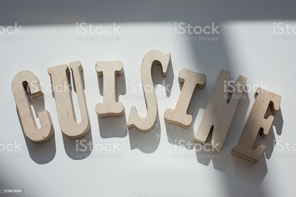 Cuisine in wooden letters stock photo