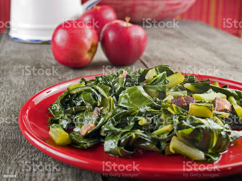 Culinary display of plate filled with bacon collard greens  stock photo