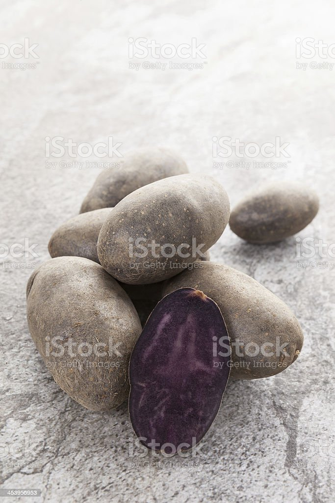 Culinary purple potatoes. stock photo