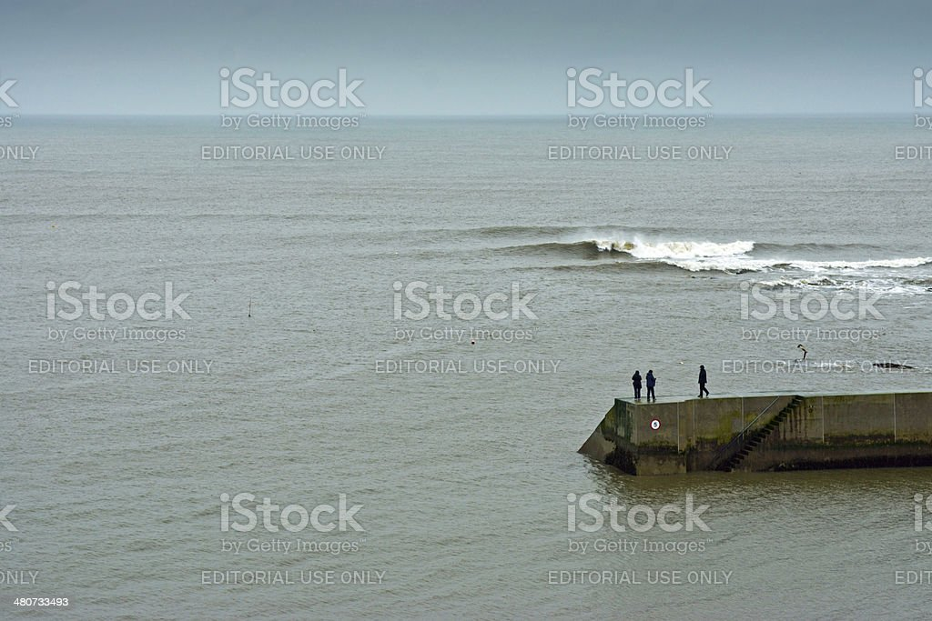 Cullercoats pier and walkers stock photo
