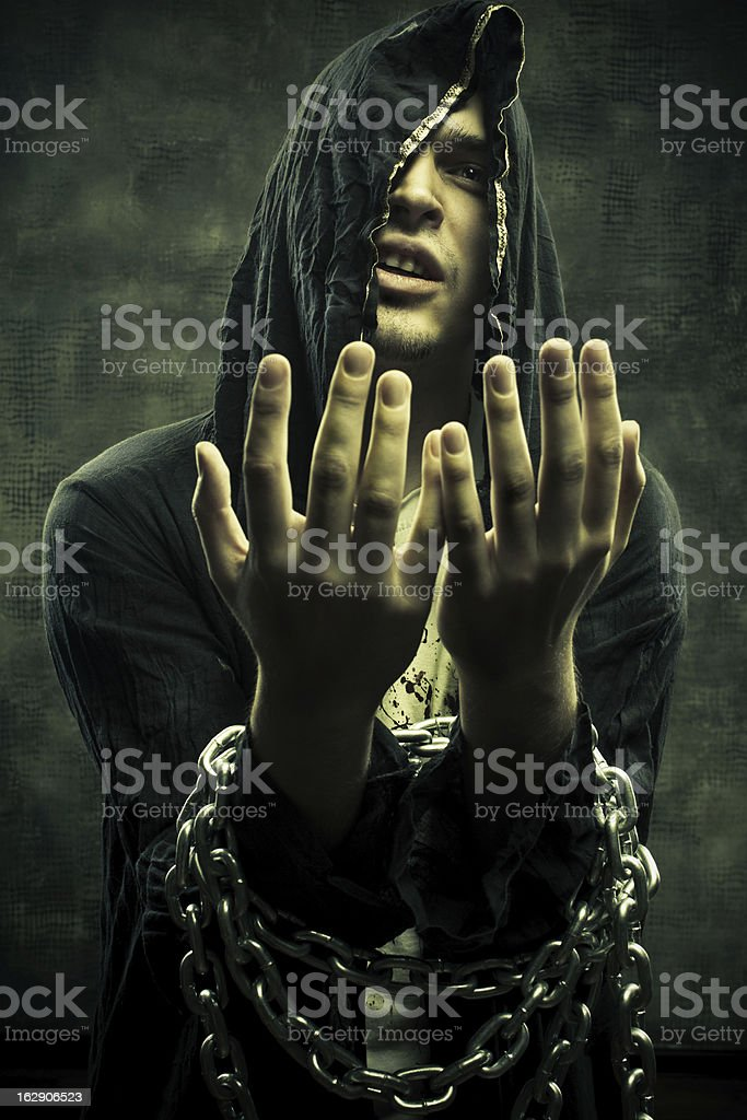 Cultist bounded by chains royalty-free stock photo