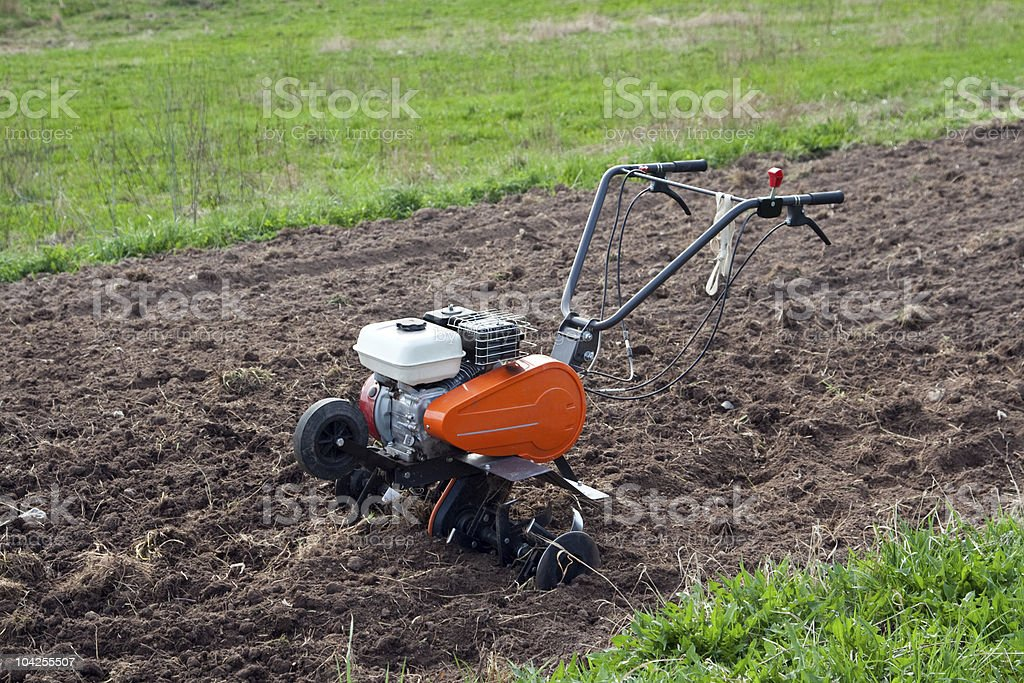 Cultivator on a field. stock photo