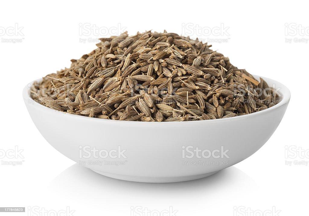 Cumin in plate stock photo