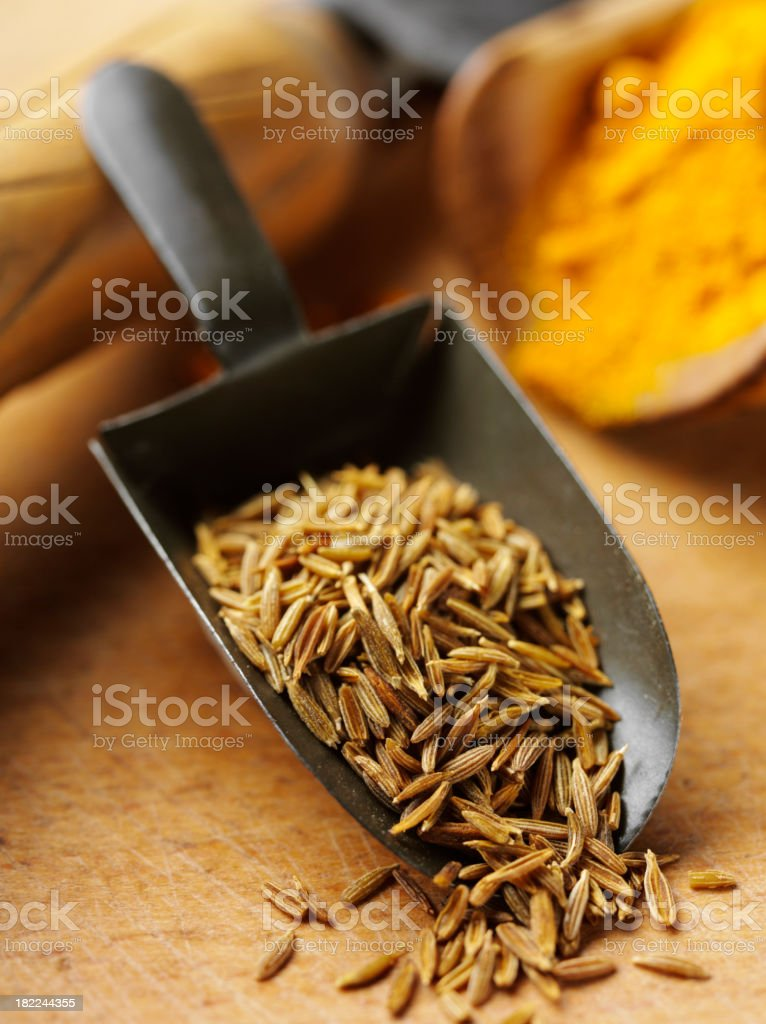 Cumin Seeds in a Old Metal Scoop stock photo
