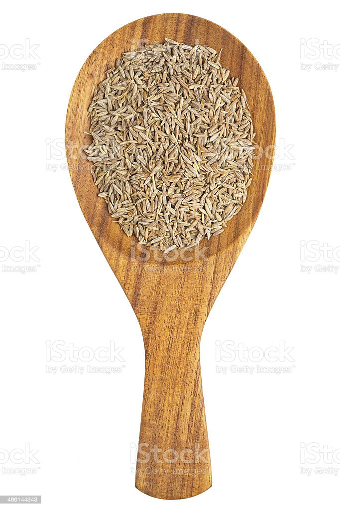 Cumin (Cuminum cyminum) seeds in the wooden spoon stock photo