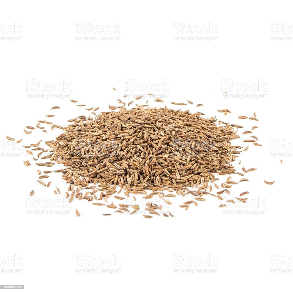 Cumin seeds or caraway isolated on white stock photo