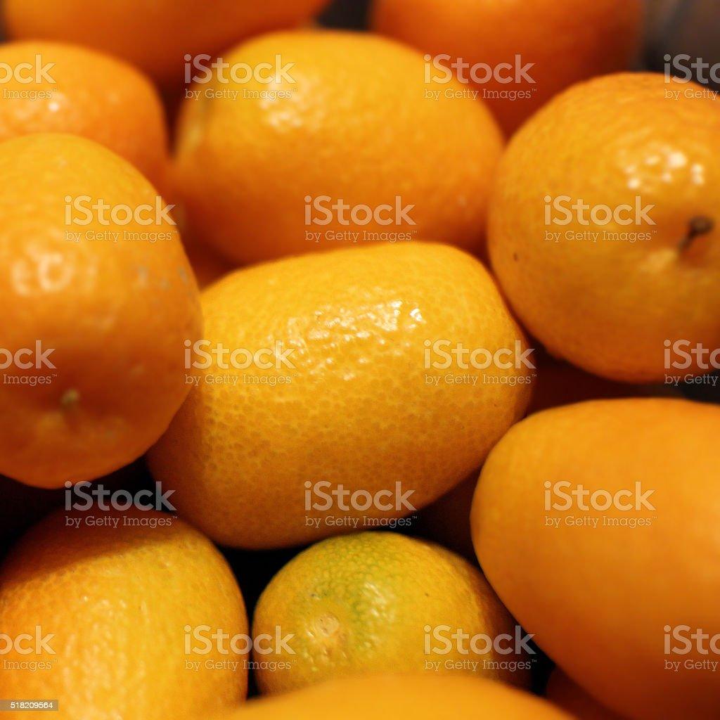 Cumquats background stock photo
