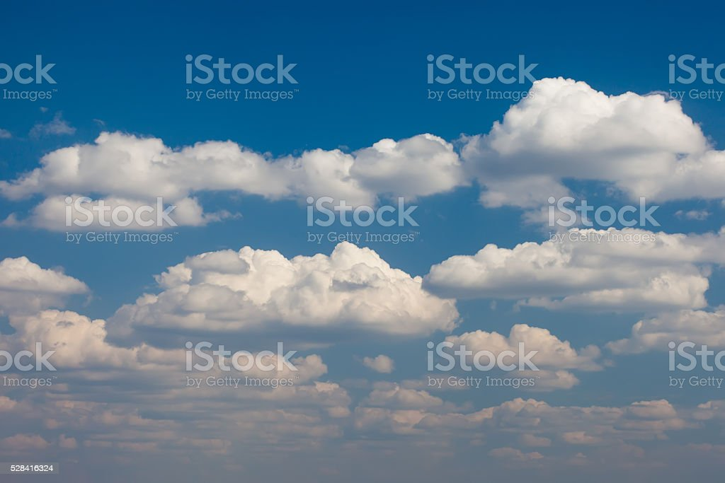 Cumulus clouds against the blue sky background stock photo
