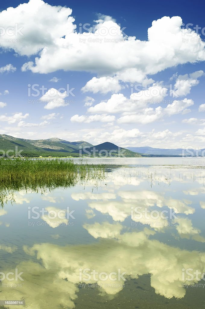 Cumulus Clouds and Reflection in the Lake royalty-free stock photo