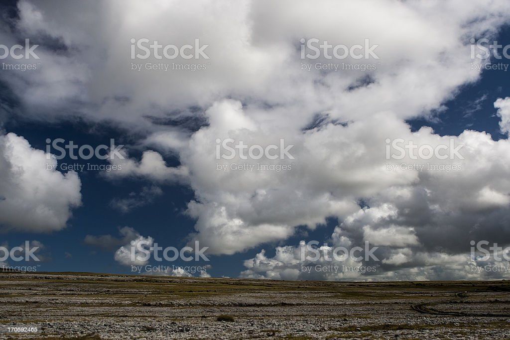 Cumulus clouds at 'The Burren' in Co. Clare, Ireland royalty-free stock photo