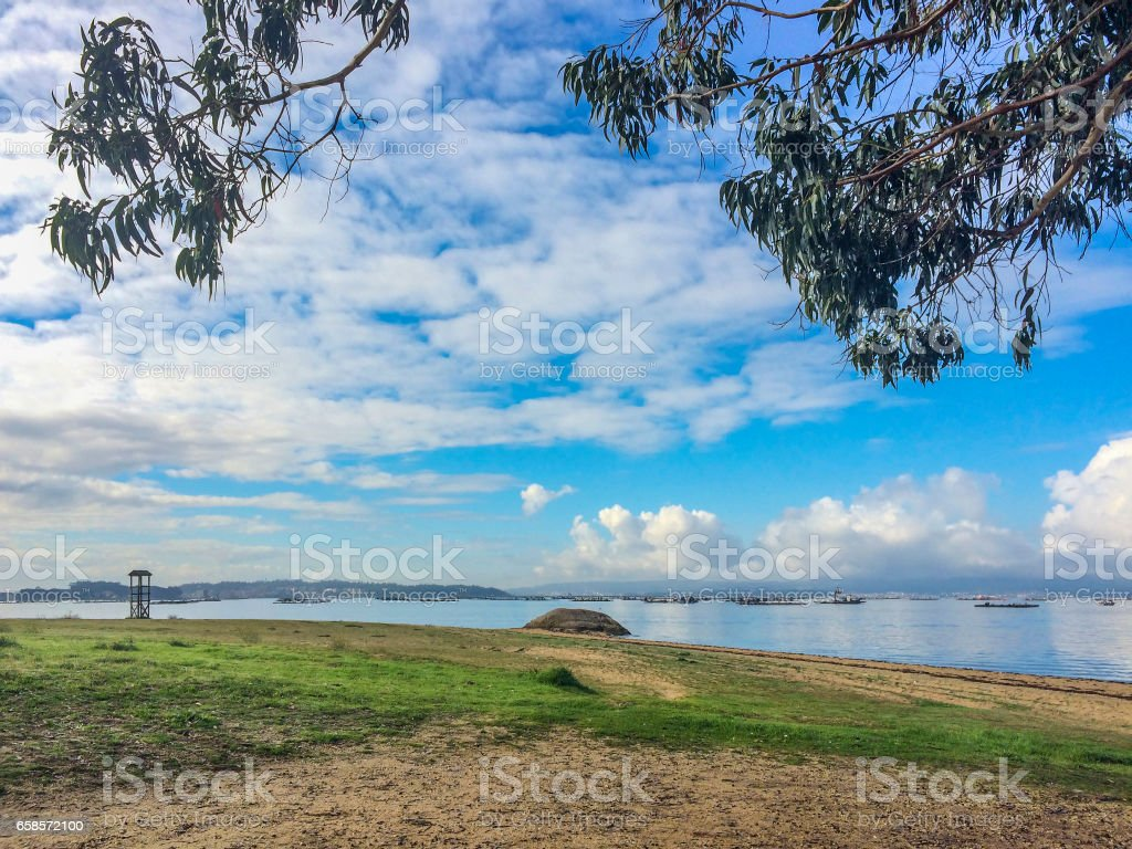 Cumulus clouds on Arousa Estuary stock photo