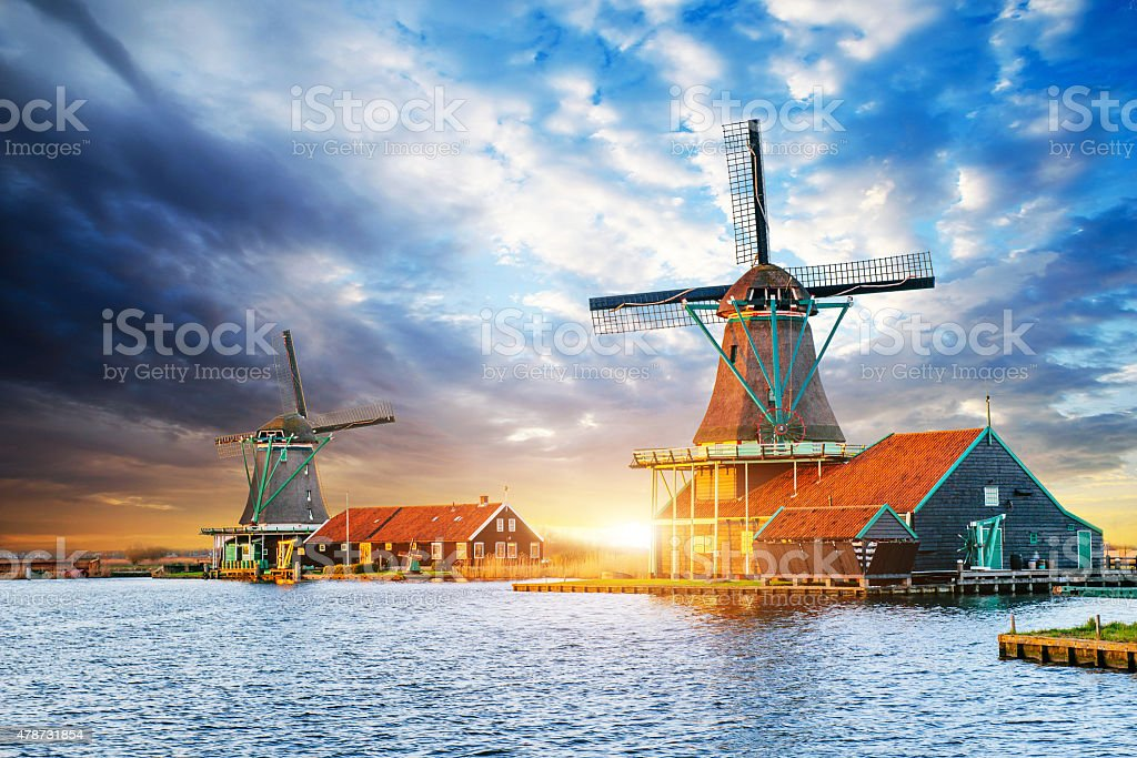 Cumulus clouds on sunset over dutch windmills in Rotterdam. Neth stock photo