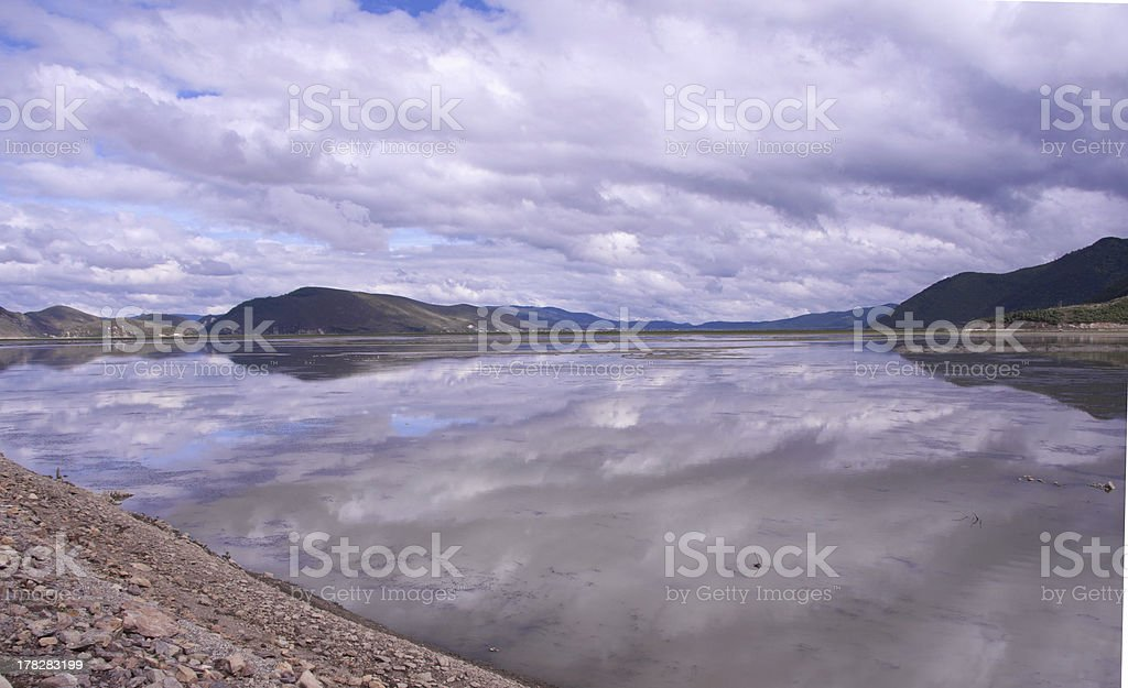 Cumulus Clouds over Lake royalty-free stock photo