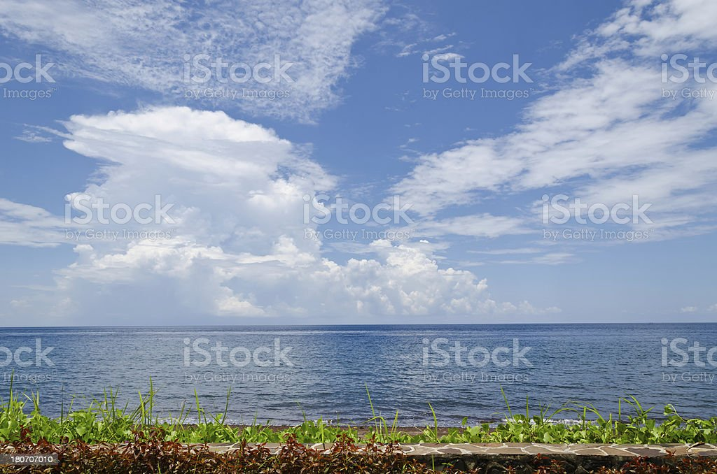 Cumulus clouds over ocean royalty-free stock photo