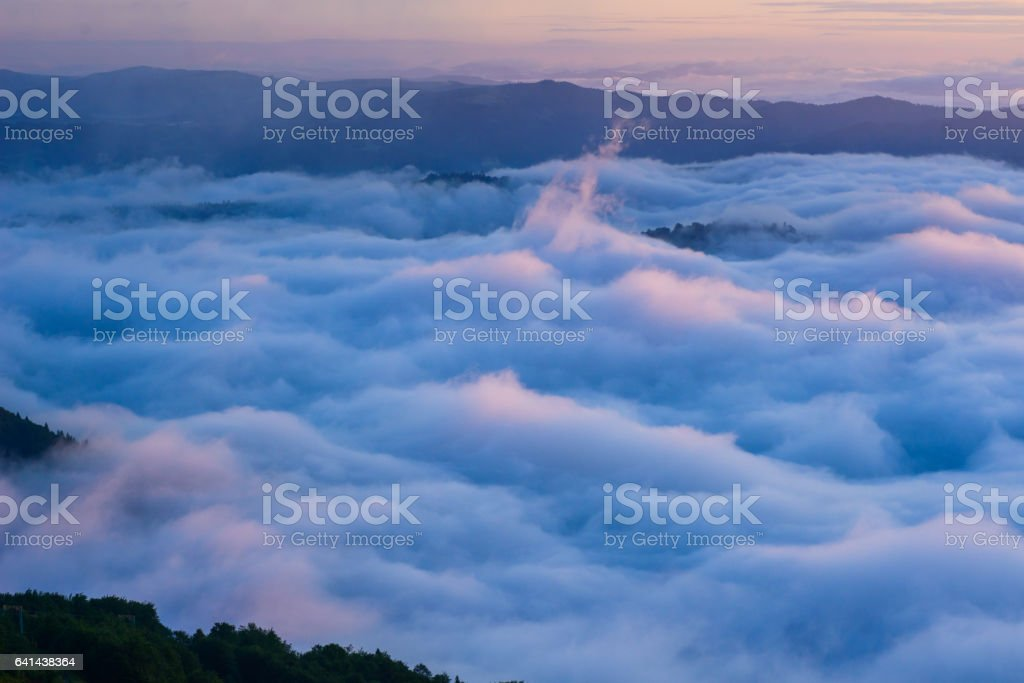 Cumulus fantastic fog in the morning sky stock photo