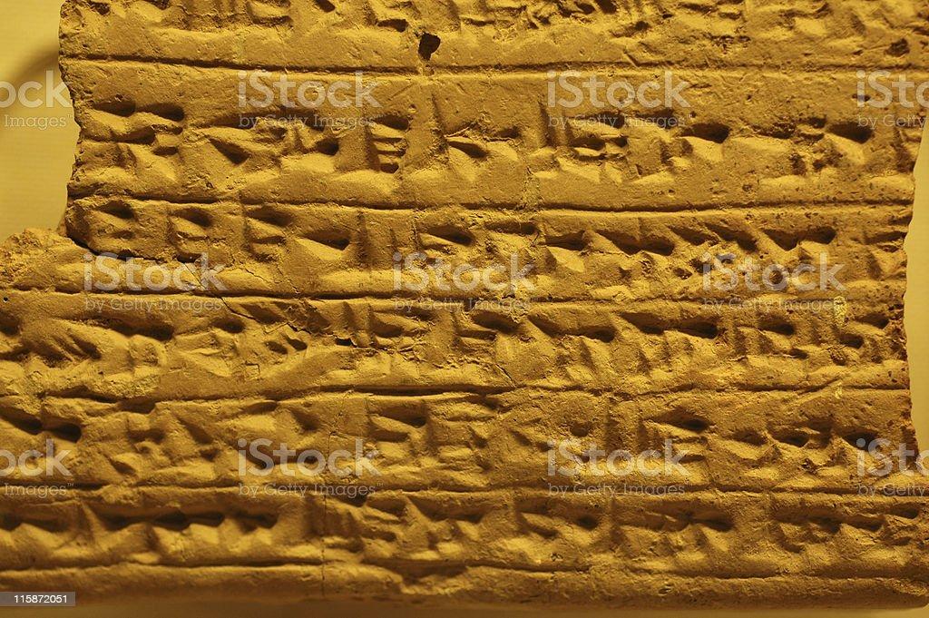 cuneiform on clay tablet stock photo