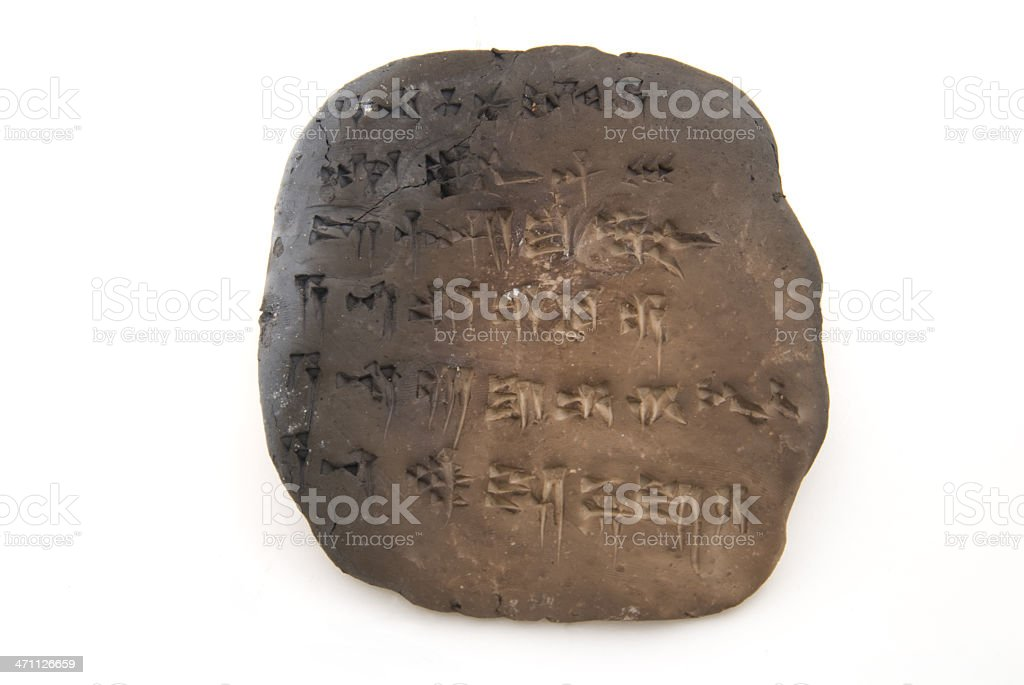 Cuneiform tablet isolated on white stock photo