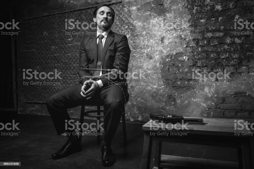 Cunning defenseless man coming up with a plan stock photo