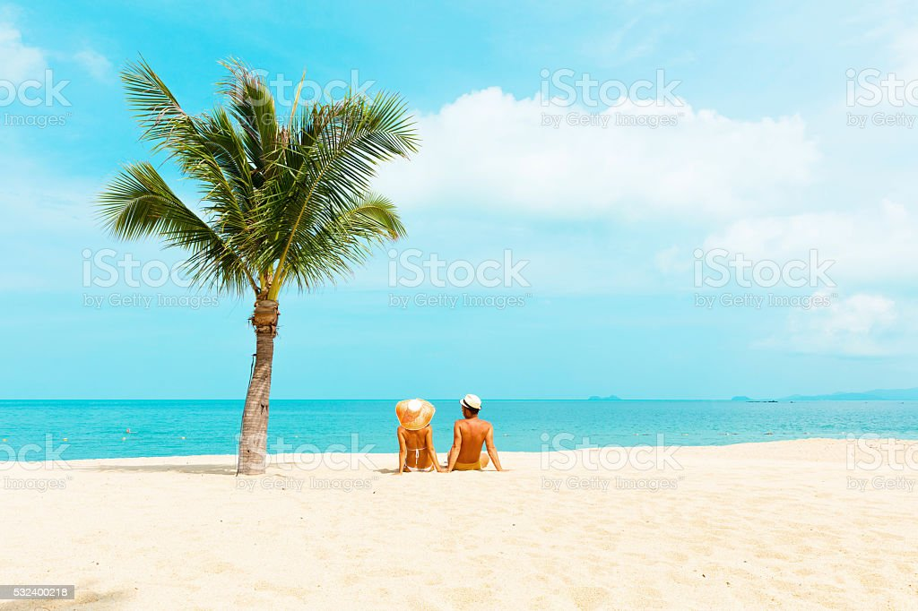 Cuople at tropical beach stock photo