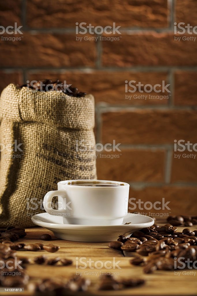 cup and bag with beans of coffee royalty-free stock photo