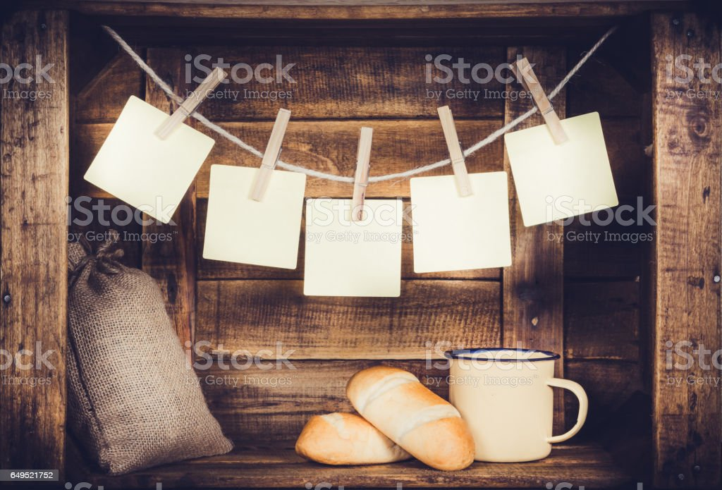 Cup and burlap with coffee bean sack and bread and post it five on wooden window-shaped box stock photo