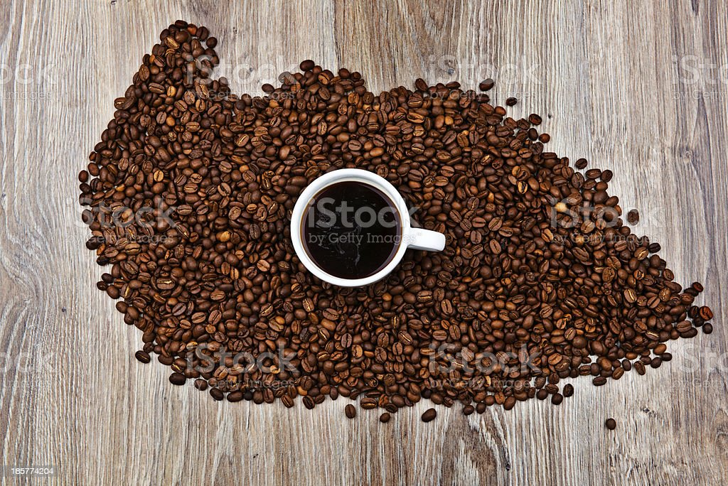Cup and roasted coffee beans royalty-free stock photo