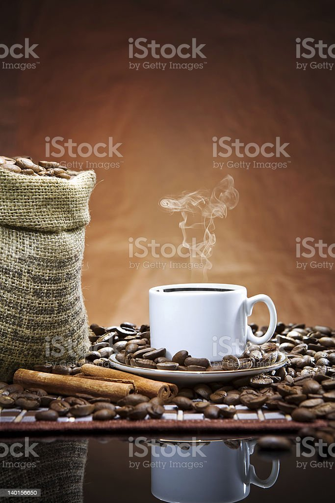cup and sack with beans royalty-free stock photo