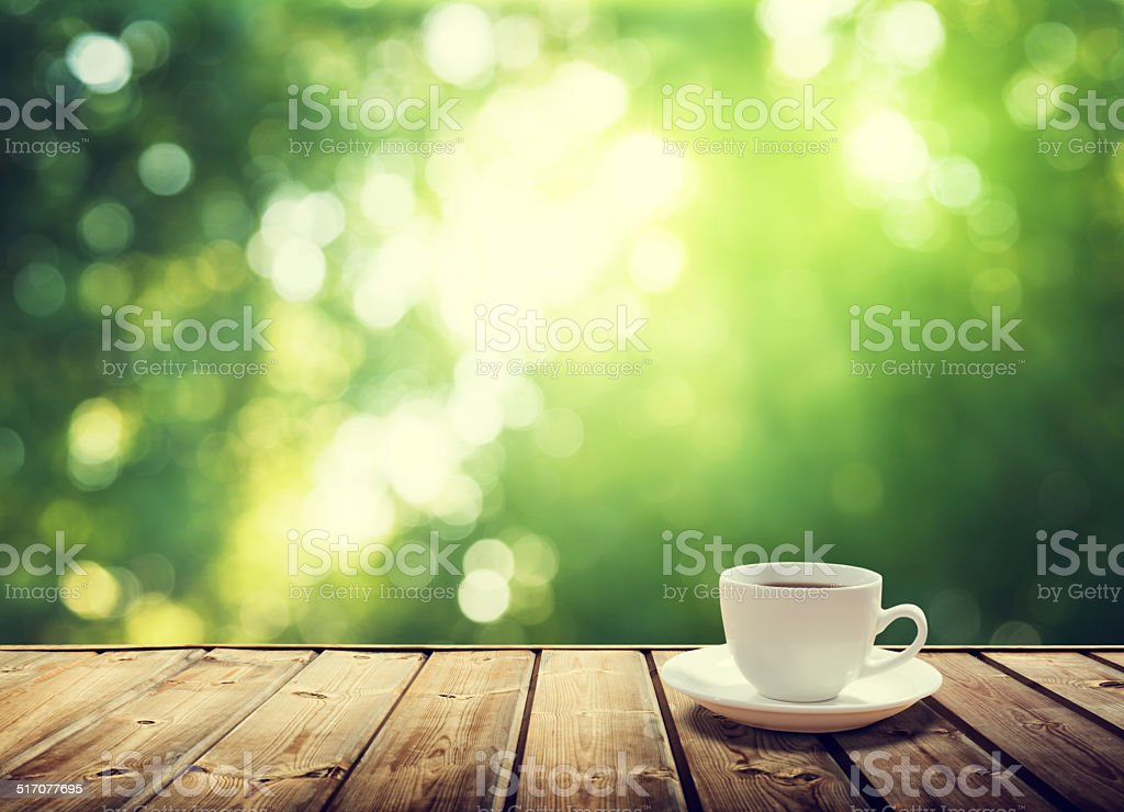 cup coffee and sunny trees background stock photo