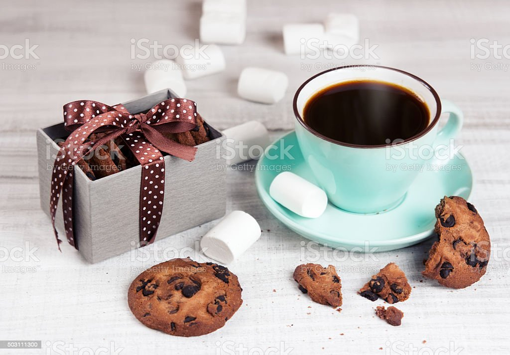 Cup coffee & cookies on white wood.Holiday pastel breackfast. stock photo