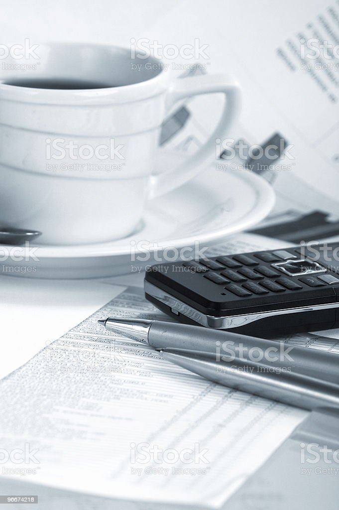 Cup  coffee on a morning paper business news stock photo