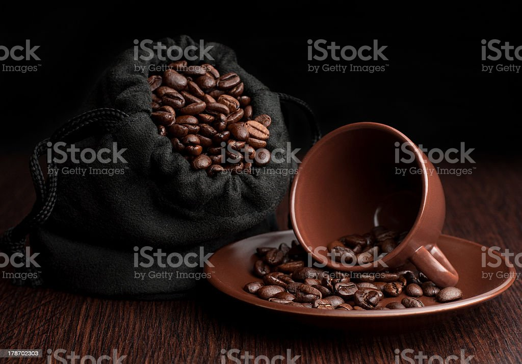 Cup coffee with grains in bag royalty-free stock photo