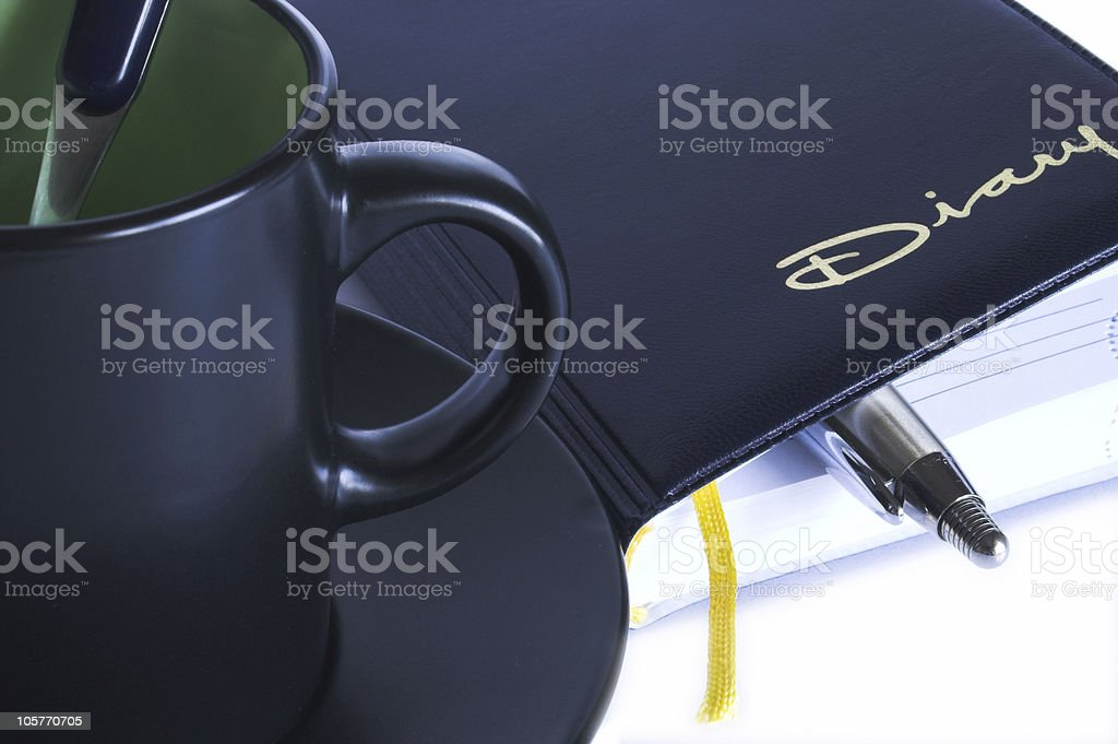Cup, diary and pensil stock photo
