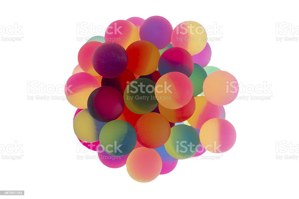 Cup filled with bicolor plastic balls stock photo