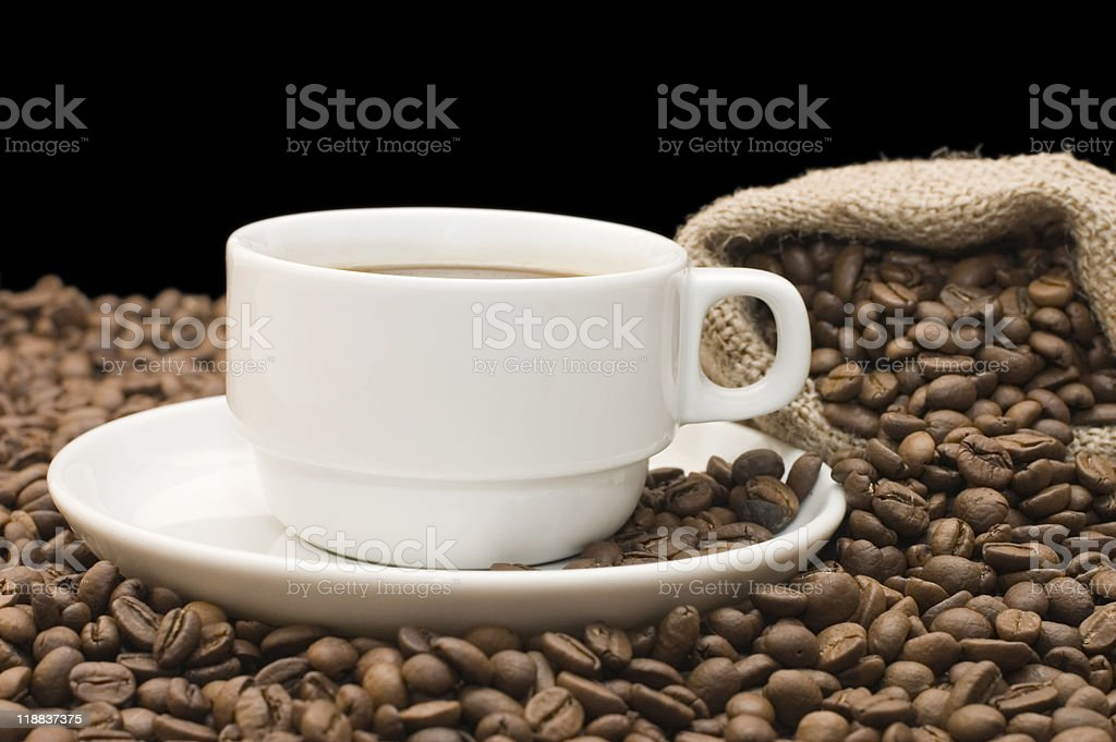 Cup from coffee on grains royalty-free stock photo