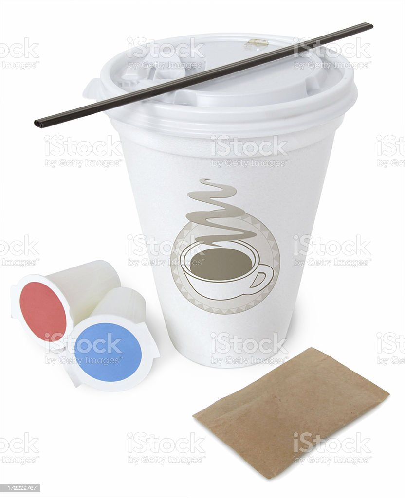 Cup from coffee shop with stirrer and cream packets stock photo