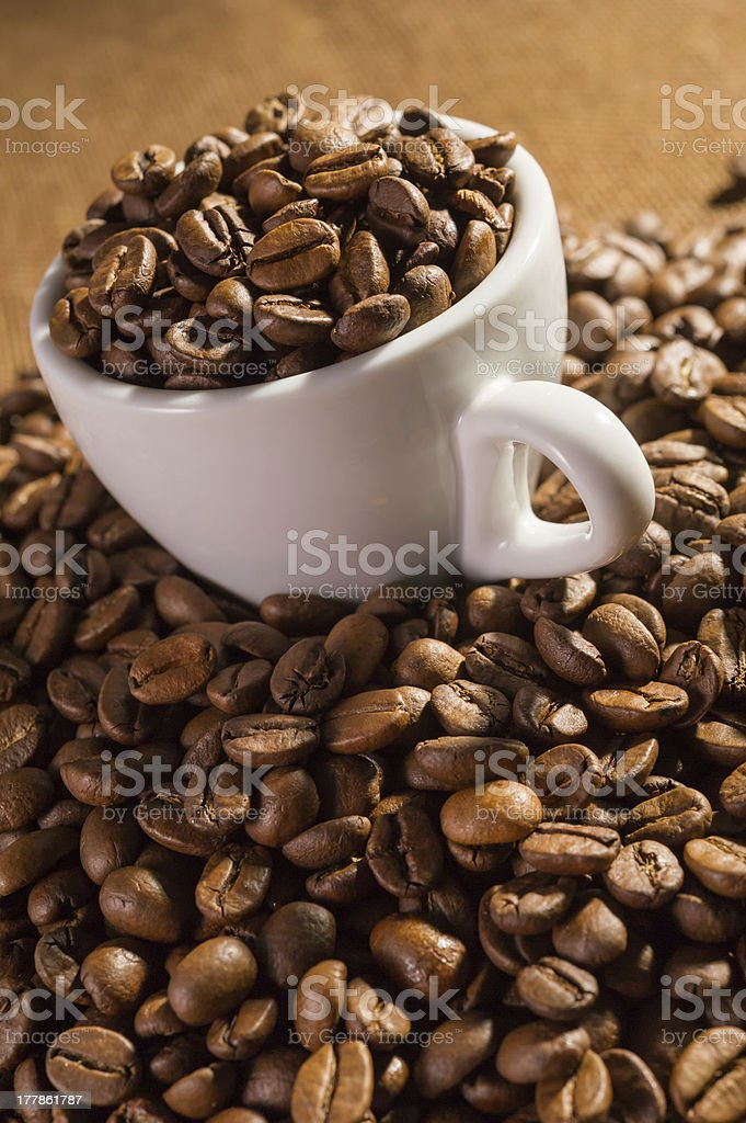 Cup full of black coffee beans royalty-free stock photo