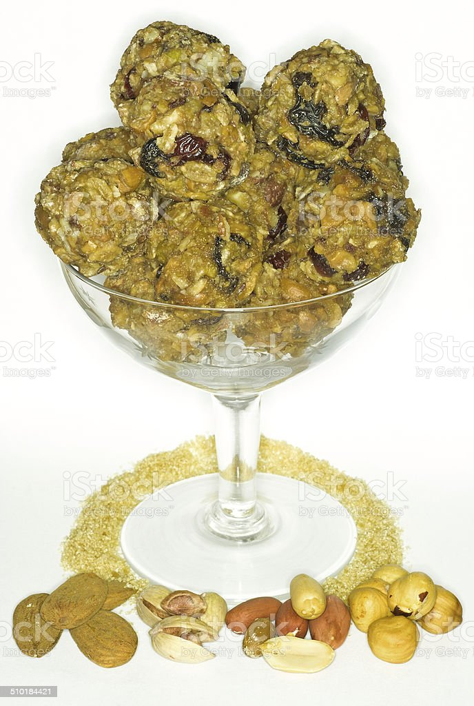Cup full of nut balls isolated white stock photo
