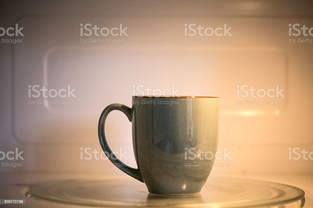cup in a microwave stock photo