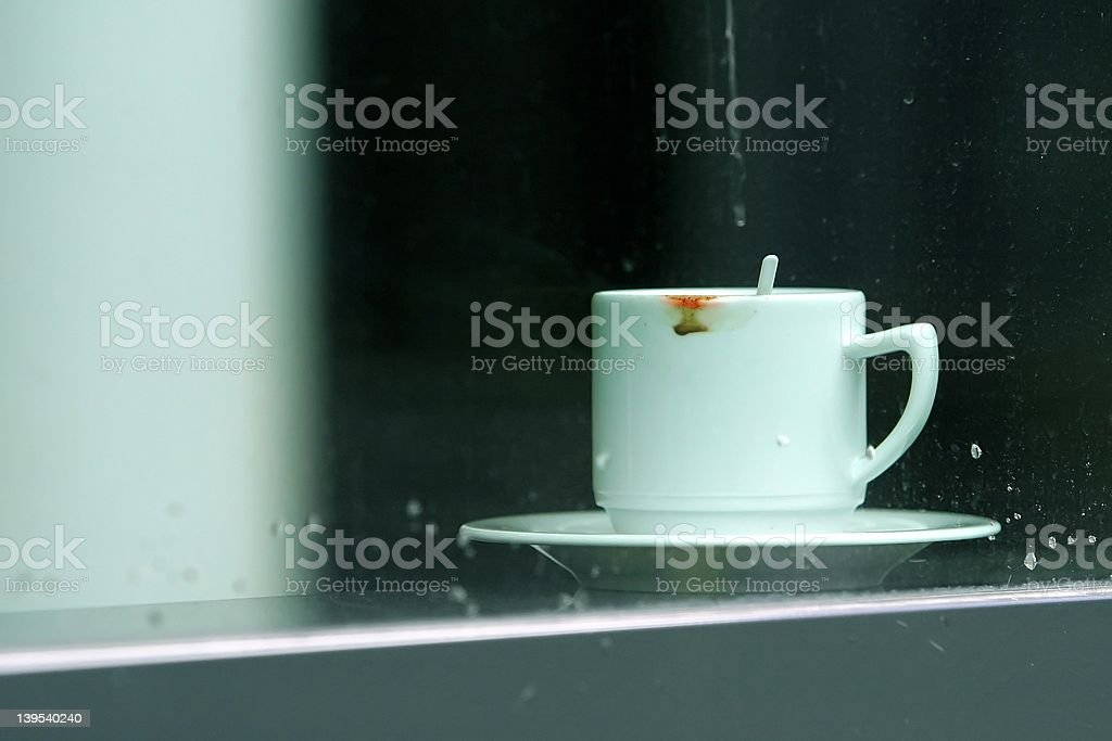 cup in a window royalty-free stock photo