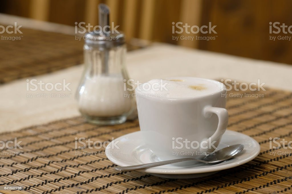 Cup of a coffee on a table stock photo