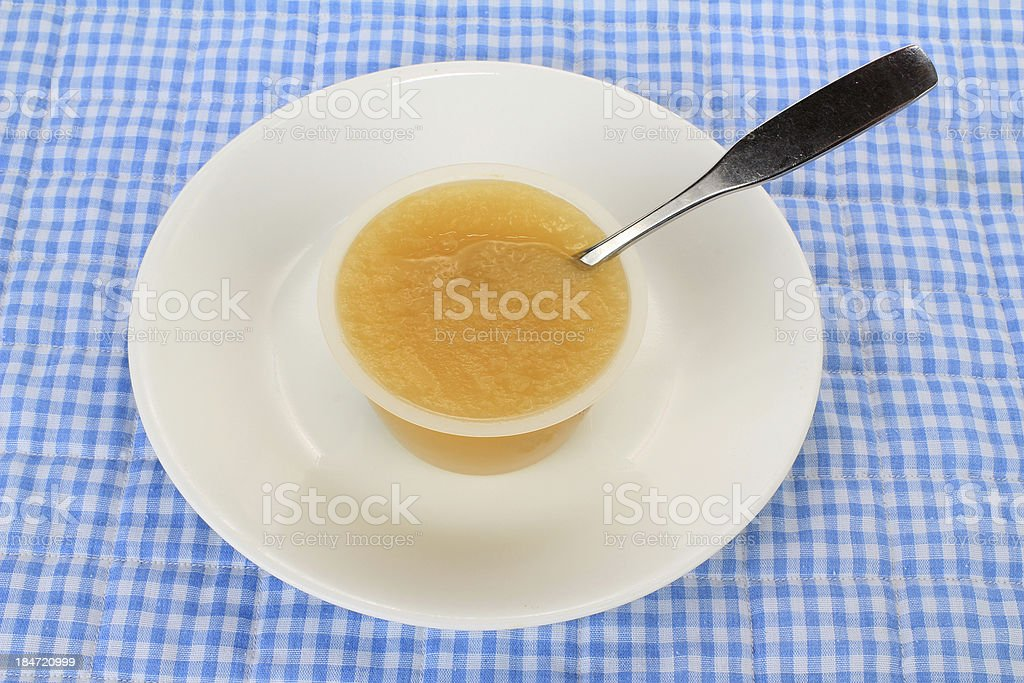 Cup of Apple Sauce stock photo
