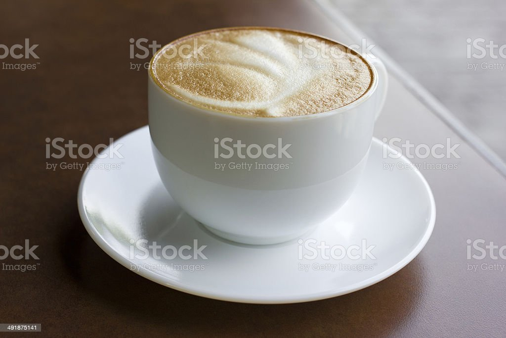 Cup of art latte on a cappuccino coffee stock photo