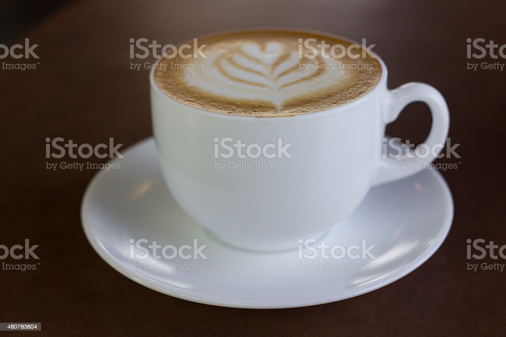 Cup of art latte or cappuccino coffee. stock photo